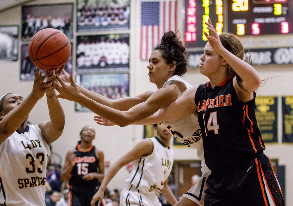 Southeast's Lunden Henry (5) goes for a rebound against Lanphier's Maria Cline (14) in the second half during the 2015 Girls City Tournament at Jim Belz Gymnasium, Thursday, Jan. 29, 2015, in Springfield, Ill. Justin L. Fowler/The State Journal-Register
