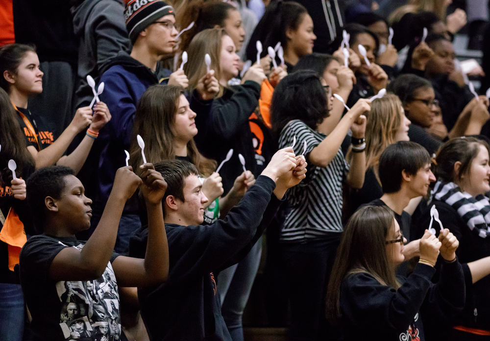The Lanphier student section uses plastic spoons to make noise as Southeast shoots free throws in the second half during the 2015 Girls City Tournament at Jim Belz Gymnasium, Thursday, Jan. 29, 2015, in Springfield, Ill. Justin L. Fowler/The State Journal-Register