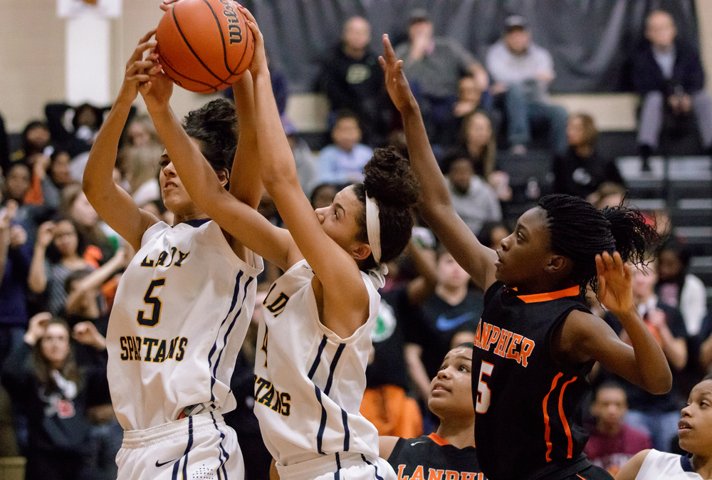 Southeast's Lunden Henry (5) and Alexis Henry (4) go for a rebound against Lanphier's Jeniya Griffin (5) in the second half during the 2015 Girls City Tournament at Jim Belz Gymnasium, Thursday, Jan. 29, 2015, in Springfield, Ill. Justin L. Fowler/The State Journal-Register