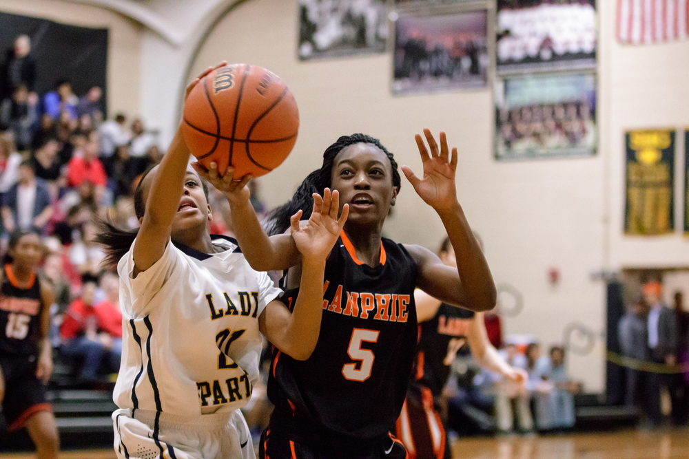 Southeast's Adrieana Brown (21) and Lanphier's Jeniya Griffin (5) go for a loose ball in the second half during the 2015 Girls City Tournament at Jim Belz Gymnasium, Thursday, Jan. 29, 2015, in Springfield, Ill. Justin L. Fowler/The State Journal-Register