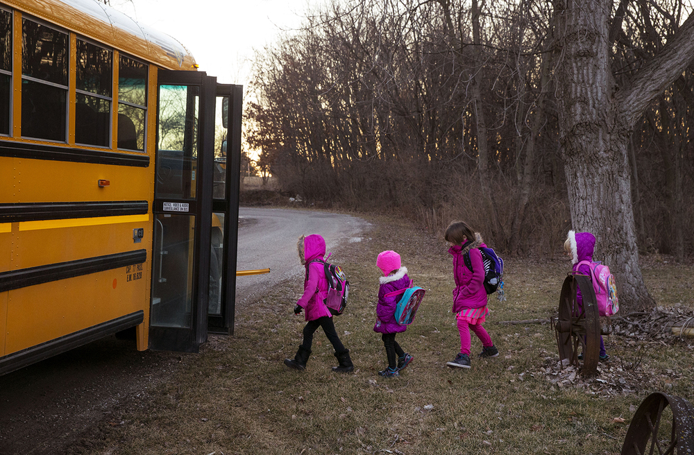 Isabella, Abigail, Elizabeth and Carly Montgomery file onto a school bus Friday, Jan. 30, 2015. The girls, who lost their mother to cancer, were adopted by Joseph and Linda Smith. Joseph is the first person in central Illinois to receive a surgical treatment that rinsed his abdominal cavity with heated chemotherapy to treat his Stage 4 cancer. Ted Schurter/The State Journal-Register