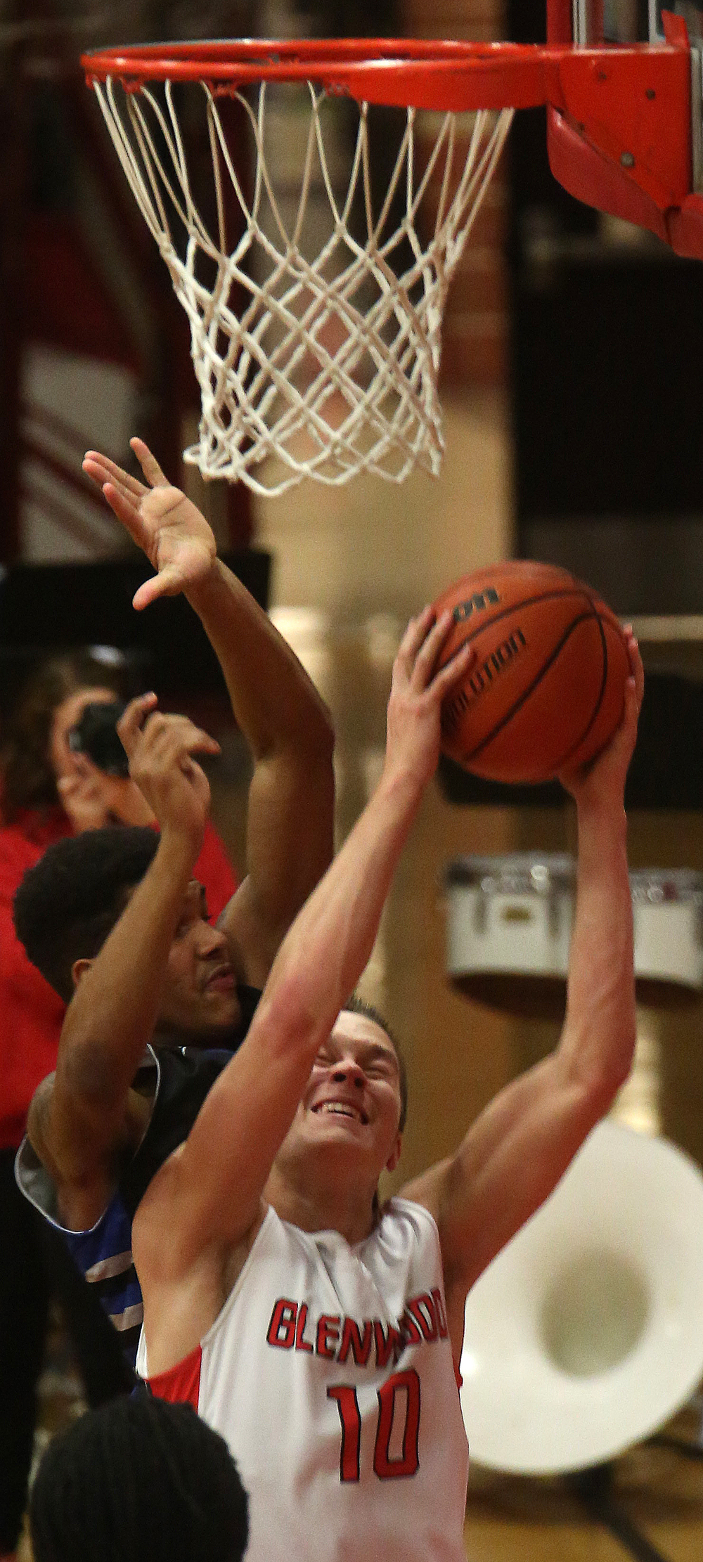 Glenwood player Cole Harper pulls down a rebound. Glenwood defeated Decatur MacArthur 61-41 in boys basketball action at the Titan's gym in Chatham on Friday evening, Jan. 30, 2015. David Spencer/The State Journal-Register