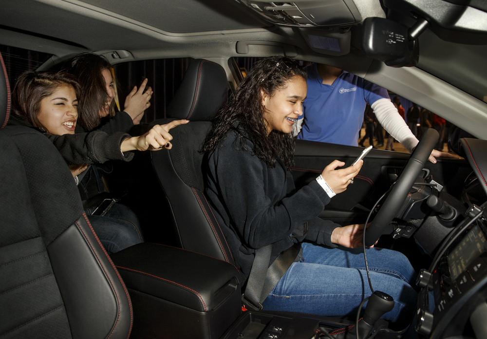 Fernanda Perez, left, and Lupita Ayala shout and yell at Alyssia Bauser before she runs into a truck as she texts while driving in a simulator at the Drive for Tomorrow program at the Prairie Capital Convention Center Tuesday, Jan. 27, 2015. The program, a joint effort by the Illinois Department of Transportation and the Illinois State Police, featured a number of distracted and impaired driving simulations aimed at educating teens on safe driving practices. Ted Schurter/The State Journal-Register