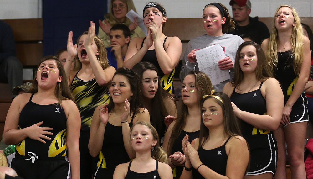 From the stands, SHG girls swim team members cheer on Nick Patton who won the 50 Yard Freestyle event in a time of 21.94. The Boys City Swim Meet was held at Eisenhower Pool in Springfield on Tuesday evening, Jan. 27, 2015. David Spencer/The State Journal-Register