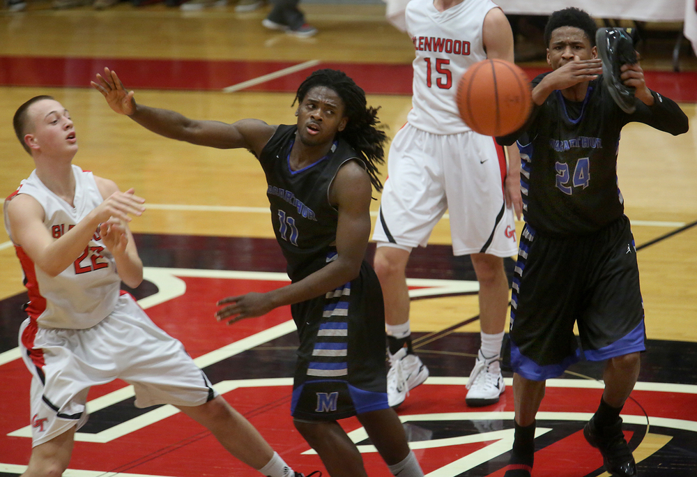 MacArthur player Terry Bond calls time out using his own shoe while Glenwood player Parker Allen passes the ball past MacArthur player Shawntrez Spates. Glenwood defeated Decatur MacArthur 61-41 in boys basketball action at the Titan's gym in Chatham on Friday evening, Jan. 30, 2015.  David Spencer/The State Journal-Register