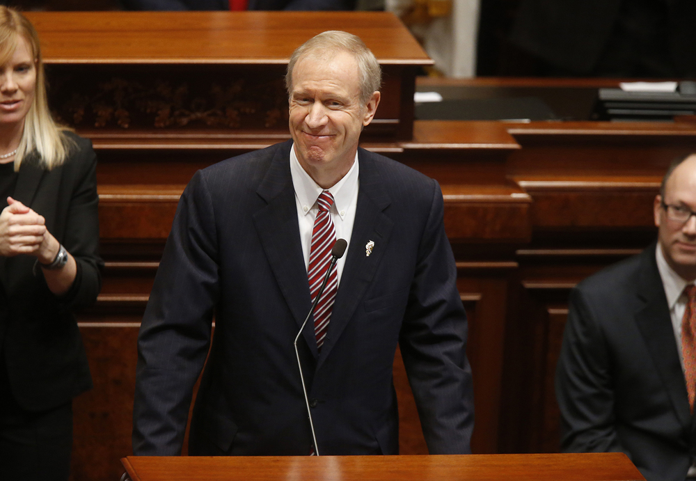 Illinois Gov. Bruce Rauner delivers his State of the State speech in the Illinois House of Representatives Wednesday, Feb. 4, 2015. Ted Schurter/The State Journal-Register