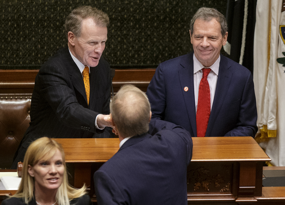 Illinois House Speaker Mike Madigan, D-Chicago, left, and Senate President John Cullerton greet Illinois Gov. Bruce Rauner before he delivers his State of the State speech in the Illinois House of Representatives Wednesday, Feb. 4, 2015. Ted Schurter/The State Journal-Register
