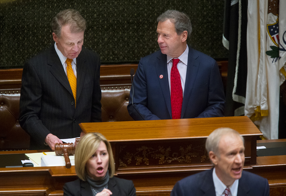Illinois House Speaker Mike Madigan, D-Chicago, left, and Senate President John Cullerton react to statements made by Illinois Gov. Bruce Rauner as he delivers his State of the State speech in the Illinois House of Representatives Wednesday, Feb. 4, 2015. Ted Schurter/The State Journal-Register