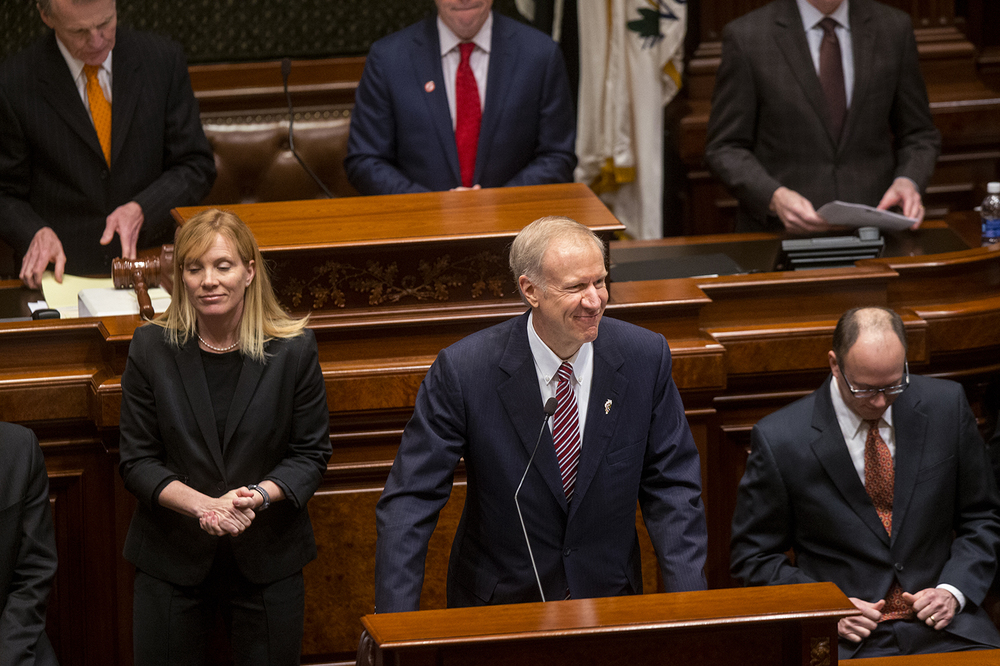 Illinois Gov. Bruce Rauner smiles at legislators after stepping to the podium to deliver his State of the State speech in the Illinois House of Representatives Wednesday, Feb. 4, 2015. Ted Schurter/The State Journal-Register