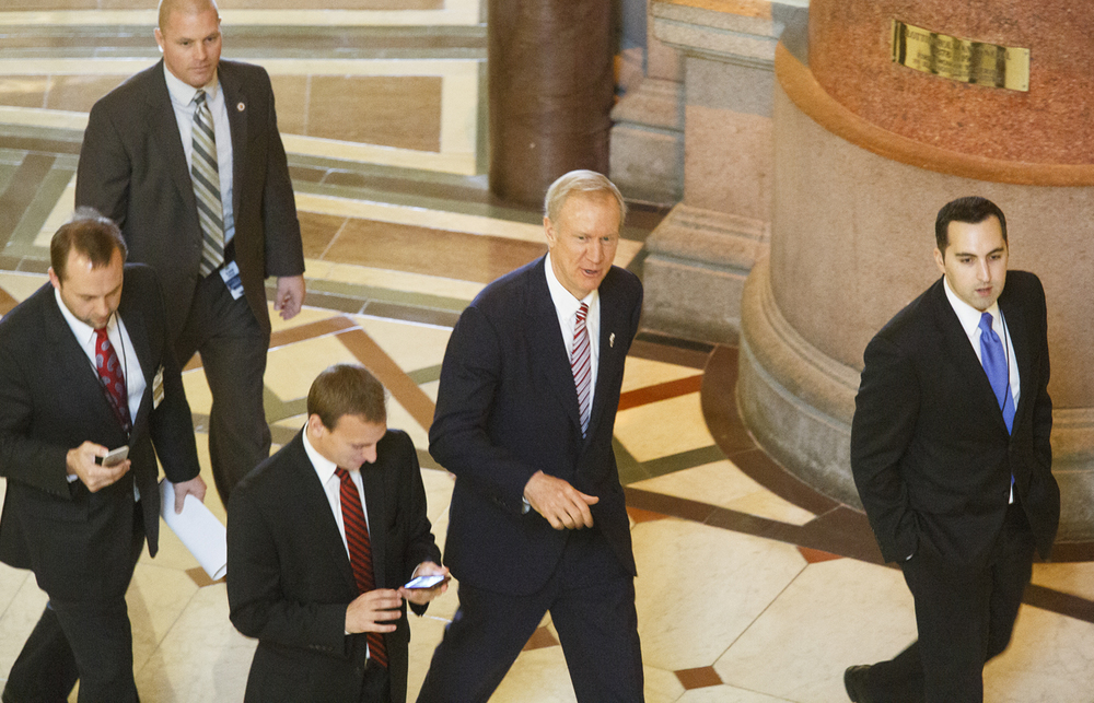 Gov. Bruce Rauner walks from his office in the Capitol to the House Chamber to deliver his State of the State Address Wednesday, Feb. 4, 2015. Rich Saal/The State Journal-Register