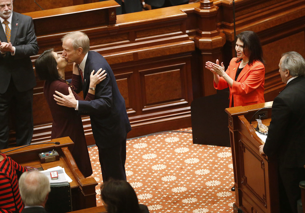 Illinois Gov. Bruce Rauner kisses his wife Diana before he delivers his State of the State speech in the Illinois House of Representatives Wednesday, Feb. 4, 2015. Ted Schurter/The State Journal-Register