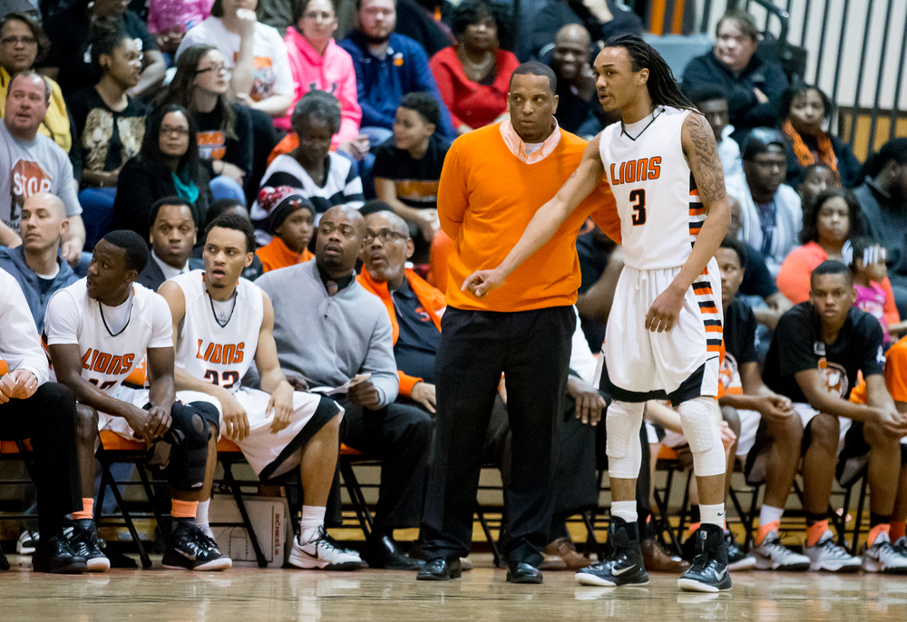 Lanphier head coach Blake Turner talks with Lanphier's Aarin Thames (3) as Glenwood during a break in play against Glenwood in the first half at the Lober-Nika Gymnasium, Friday, Feb. 6, 2015, in Springfield , Ill. Justin L. Fowler/The State Journal-Register