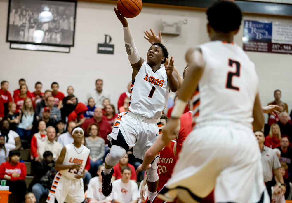 Lanphier's Yaakema Rose (1) puts up a shot against Glenwood in the first half at the Lober-Nika Gymnasium, Friday, Feb. 6, 2015, in Springfield , Ill. Justin L. Fowler/The State Journal-Register