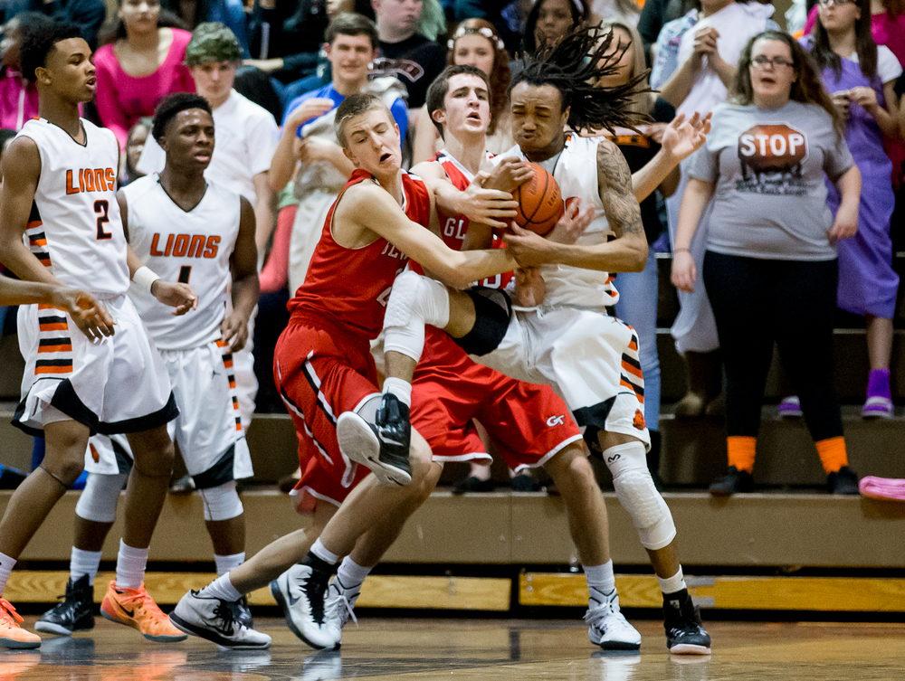 Lanphier's Aarin Thames (3) fights for a rebound against Glenwood's Karson Aherin (23) in the first half at the Lober-Nika Gymnasium, Friday, Feb. 6, 2015, in Springfield , Ill. Justin L. Fowler/The State Journal-Register