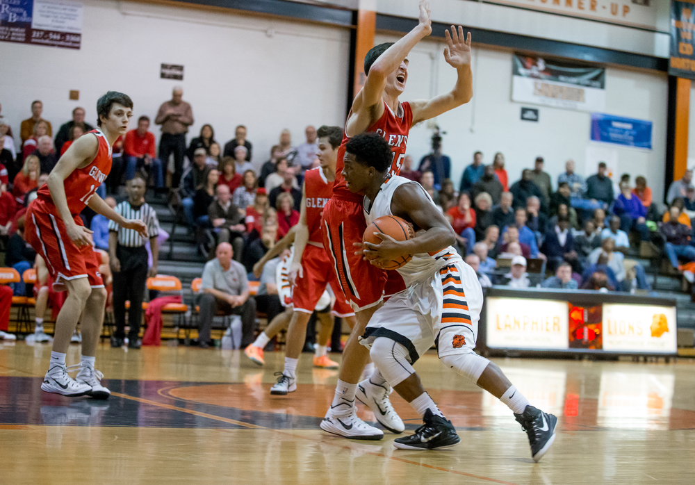 Glenwood's Joel Alexander (15) draws the charge against Lanphier's Yaakema Rose (1) as he went towards the basket in the first half at the Lober-Nika Gymnasium, Friday, Feb. 6, 2015, in Springfield , Ill. Justin L. Fowler/The State Journal-Register