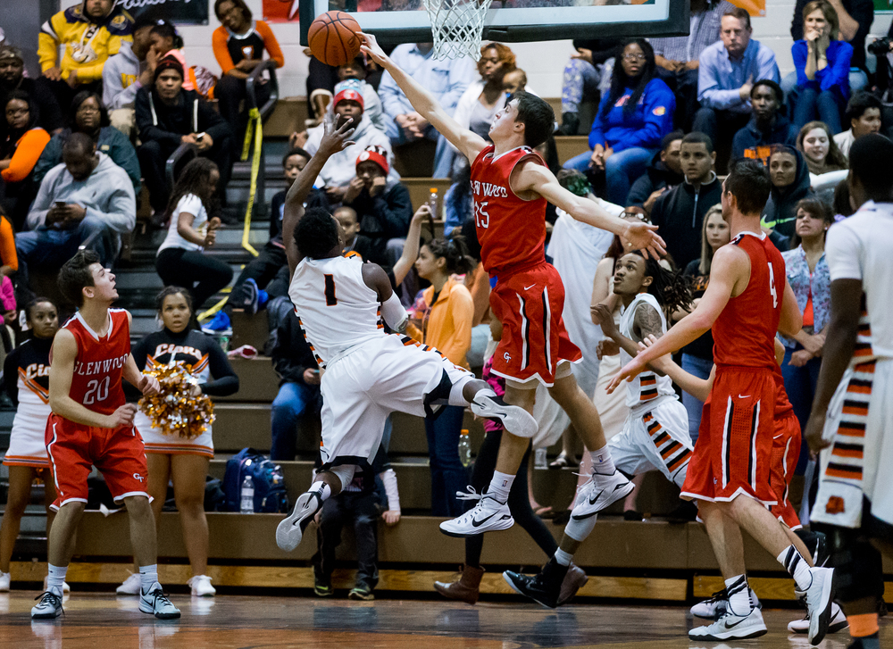 Glenwood's Joel Alexander (15) blocks a shot from Lanphier's Yaakema Rose (1) during the second half at the Lober-Nika Gymnasium, Friday, Feb. 6, 2015, in Springfield , Ill. Justin L. Fowler/The State Journal-Register