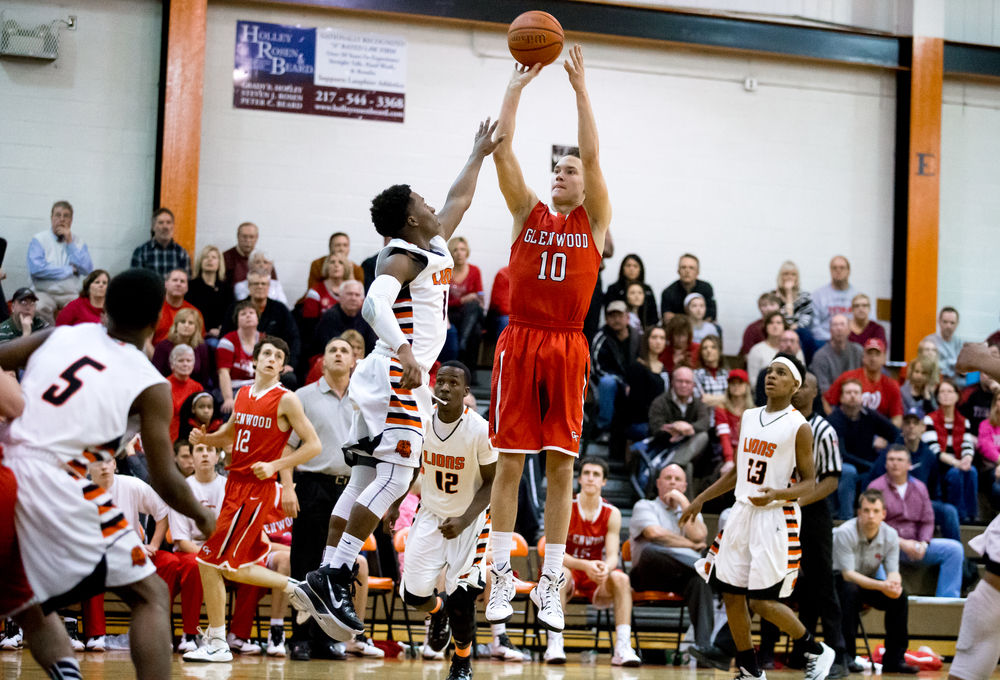 Glenwood's Cole Harper fires a jumper against Lanphier's Yaakema Rose (1) in the second half at the Lober-Nika Gymnasium, Friday, Feb. 6, 2015, in Springfield , Ill. Justin L. Fowler/The State Journal-Register