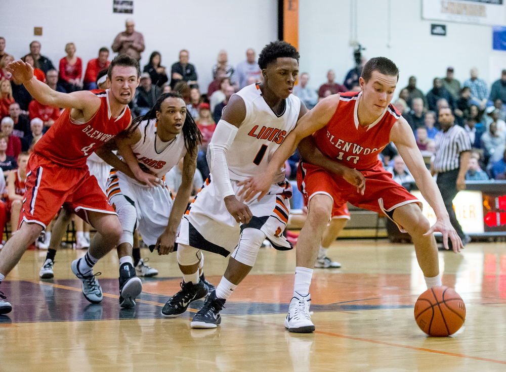 Glenwood's Cole Harper (10) spins around the defense of Lanphier's Yaakema Rose (1) in the second half at the Lober-Nika Gymnasium, Friday, Feb. 6, 2015, in Springfield , Ill. Justin L. Fowler/The State Journal-Register