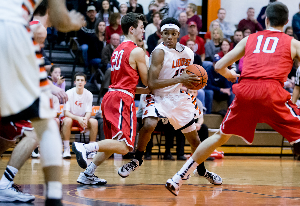 Lanphier's Aundrae Williams (23) drives towards the basket against Glenwood's Ethan Hunt (20) during the first half at the Lober-Nika Gymnasium, Friday, Feb. 6, 2015, in Springfield , Ill. Justin L. Fowler/The State Journal-Register