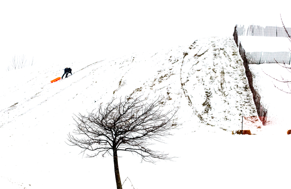 A sledder trudges up the hill in heavy wet snow at Centennial Park, Sunday, Feb. 1, 2015, in Springfield , Ill. Predictions of up to 8 inches of snow were expected, but only a few inches of wet snow fell across the area. Justin L. Fowler/The State Journal-Register