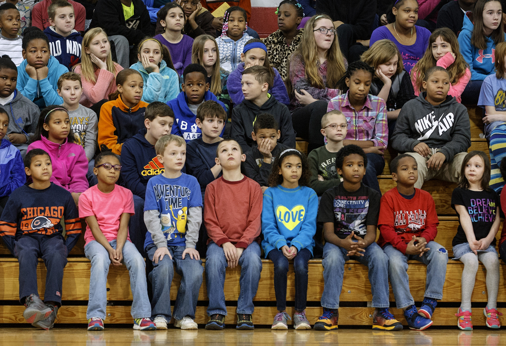 Springfield Ball Charter School students listen as mayoral candidates answer questions during a student-led Springfield Mayoral Candidate Forum at the school on Monday, February 2, 2015.  Ted Schurter/The State Journal-Register