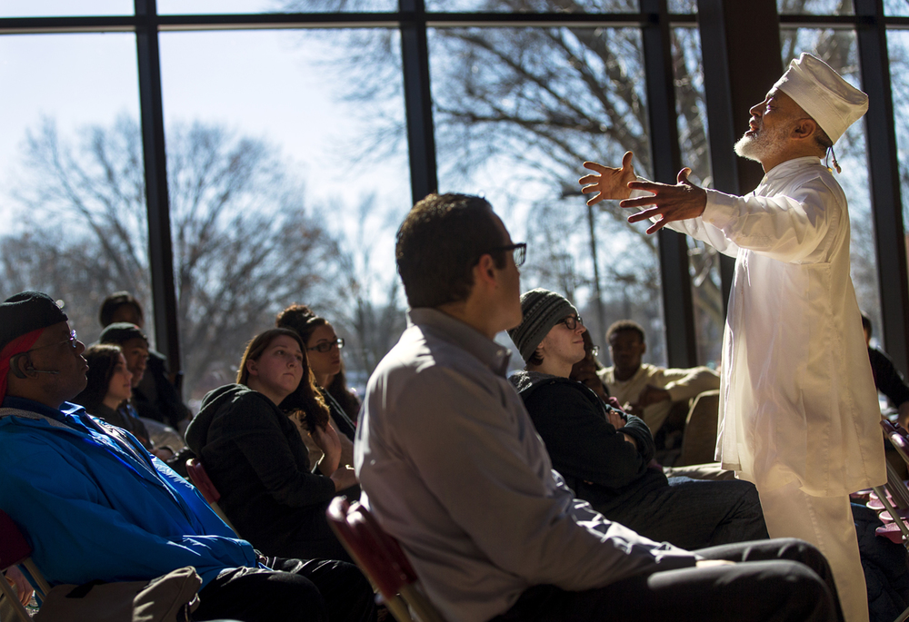 Tejumola Ologboni, a storyteller, folklorist, oral historian and percussionist, speaks to students gathered at Lincoln Land Community College for the kickoff of Black History Month Monday, Feb. 2, 2015. Ted Schurter/The State Journal-Register
