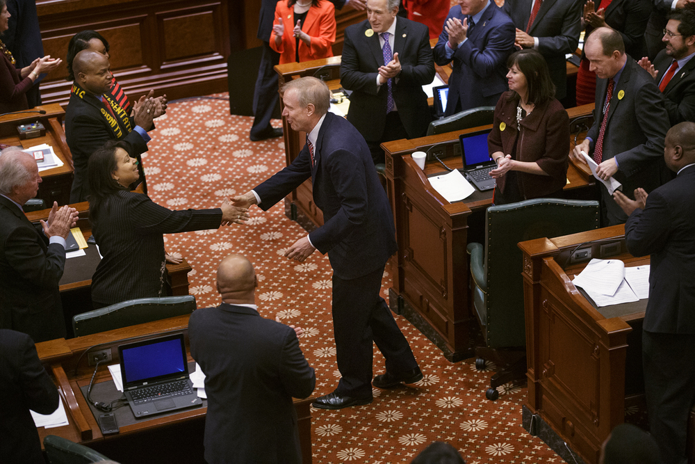 Illinois Gov. Bruce Rauner greets legislators before delivering his State of the State speech in the Illinois House of Representatives Wednesday, Feb. 4, 2015. Ted Schurter/The State Journal-Register