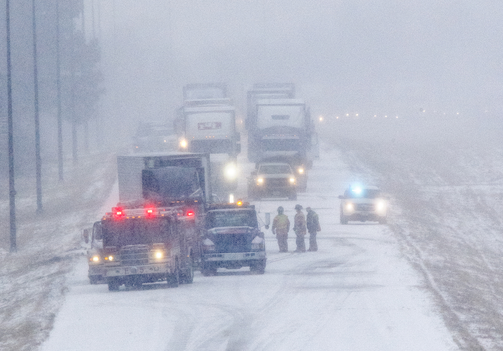 Rescue officials responded to an accident on Interstate 55 Wednesday, Feb. 4, 2015. An afternoon snow storm slowed area traffic with multiple reports of vehicles sliding off  roadways. Ted Schurter/The State Journal-Register