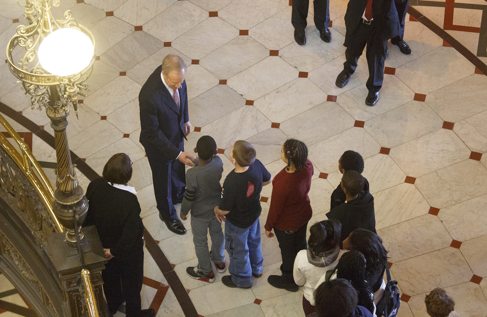 Gov. Bruce Rauner pauses to greet children who were touring the Capitol Wednesday, Feb. 4, 2015 before delivering his State of the State Address to a joint session of the General Assembly. Rich Saal/The State Journal-Register