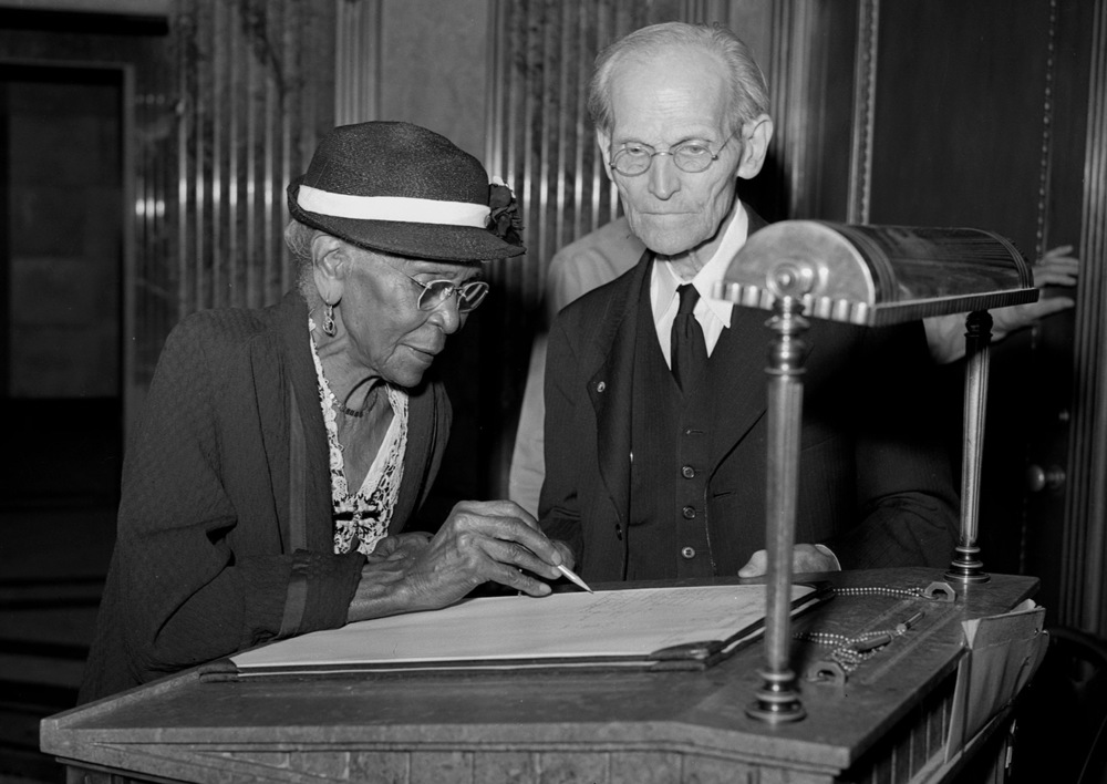 Fay watches as Adeline Jenkins, 99, signs the tomb guest register, Sept. 21, 1947. Jenkins had been at the tomb to attend an observance of the 84th anniversary of the signing by Lincoln of the Emancipation Proclamation. File/The State Journal-Register