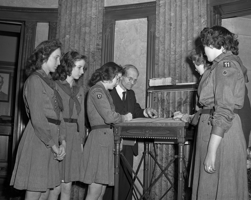 TOP: Fay watches as Adeline Jenkins, 99, signs the tomb guest register,Sept. 21, 1947. Jenkins had been at the tomb to attend an observance of the 84th anniversary of the signing by Lincoln of the Emancipation Proclamation. ABOVE: A Girl Scout troop from Decatur signs the guest register at the tomb Feb. 12, 1945.