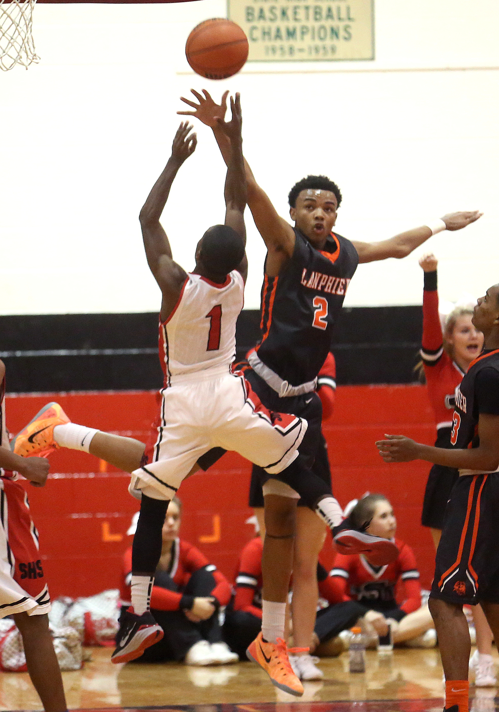 Springfield player Taivon Kincaid at left and Lanphier's Cardell McGee battle for the ball. Lanphier defeated Springfield High School 64-54 in boys basketball action at Springfield's Willard Duey Gym on Tuesday evening, Feb. 10, 2015. David Spencer/The State Journal-Register
