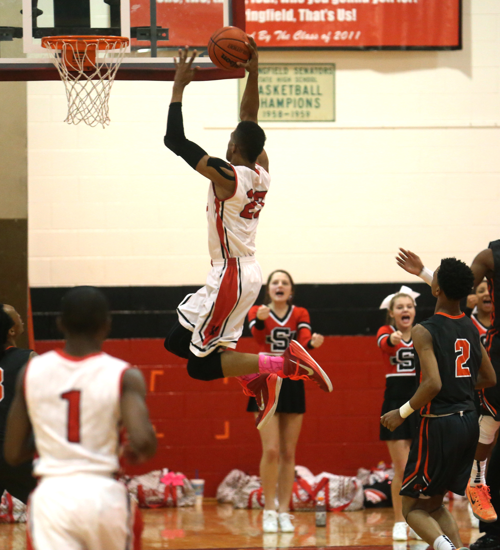 Springfield player Obediah Church prepares to slam dunk the ball. Lanphier defeated Springfield High School 64-54 in boys basketball action at Springfield's Willard Duey Gym on Tuesday evening, Feb. 10, 2015. David Spencer/The State Journal-Register
