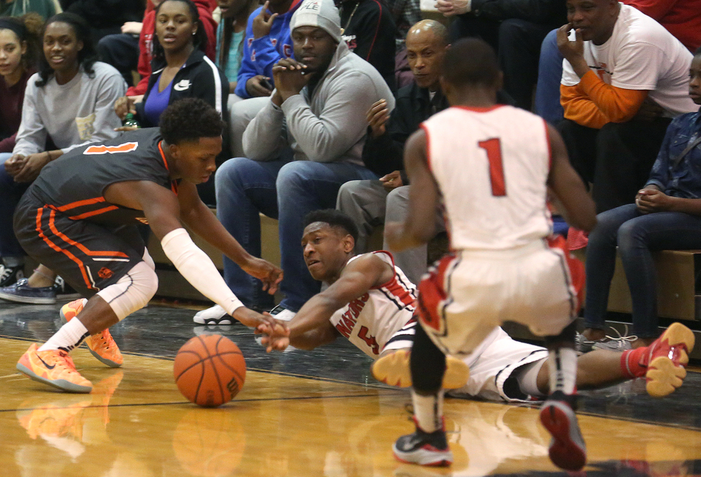 A floor scramble for a loose ball takes place between Springfield player Isaac Nelson and Lanphier player Yaakema Rose. Lanphier defeated Springfield High School 64-54 in boys basketball action at Springfield's Willard Duey Gym on Tuesday evening, Feb. 10, 2015. David Spencer/The State Journal-Register