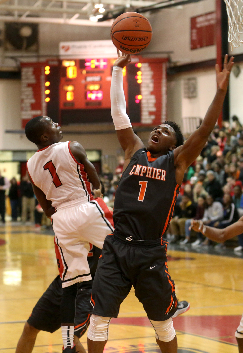 Lanphier's Yaakema Rose looks to recover a rebound. Lanphier defeated Springfield High School 64-54 in boys basketball action at Springfield's Willard Duey Gym on Tuesday evening, Feb. 10, 2015. David Spencer/The State Journal-Register
