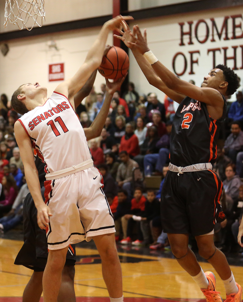 Lanphier's Cardell McGee at right gets tangled up with Springfield's Matt Sandberg while trying to recover a rebound. Lanphier defeated Springfield High School 64-54 in boys basketball action at Springfield's Willard Duey Gym on Tuesday evening, Feb. 10, 2015. David Spencer/The State Journal-Register