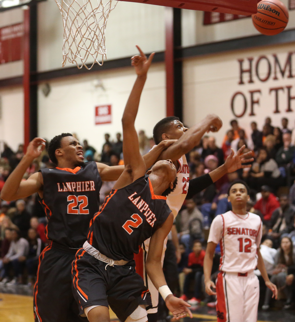 Lanphier's Cardell McGee at center and Daryl Jackson at left battle Springfield's Obediah Church. Lanphier defeated Springfield High School 64-54 in boys basketball action at Springfield's Willard Duey Gym on Tuesday evening, Feb. 10, 2015. David Spencer/The State Journal-Register