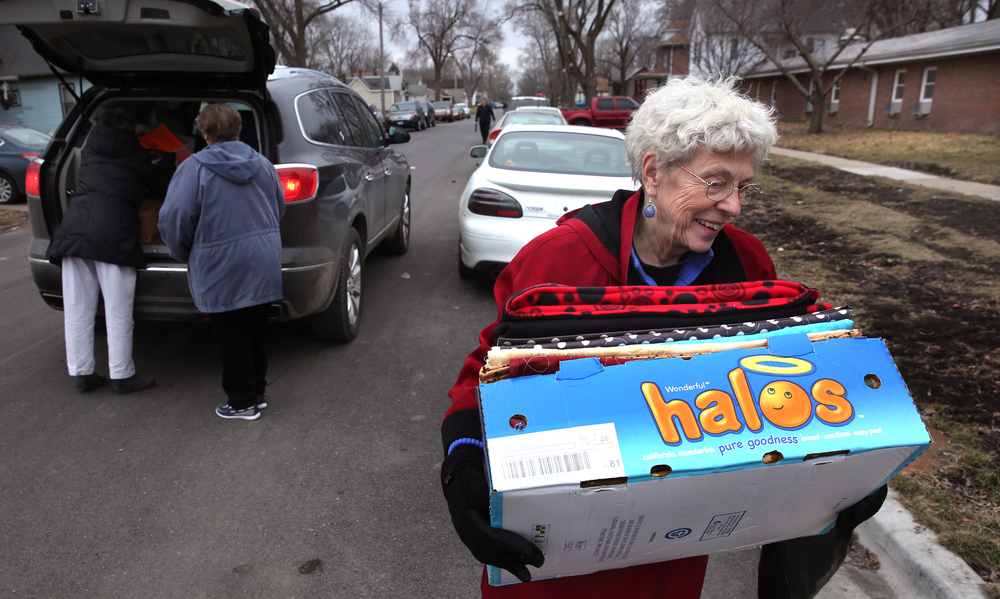 Home and Community Education member Thelma Harms carries a box of finished quilts into the nursing home Wednesday afternoon.David Spencer/The State Journal-Register
