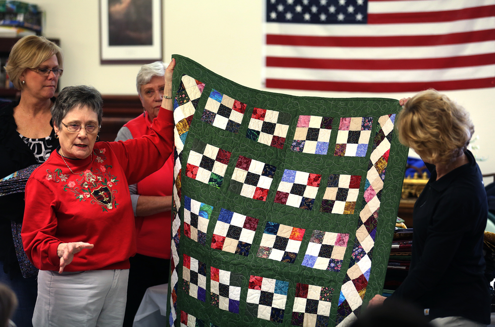 "A special ""Rosalie's Legacy"" quilt in memory of Rosalie Conklin made by members of the Sangamon County Association of Home and Community Education is presented to Tina Kern at right by Linda Sichlan at the nursing home Wednesday.David Spencer/The State Journal-Register"