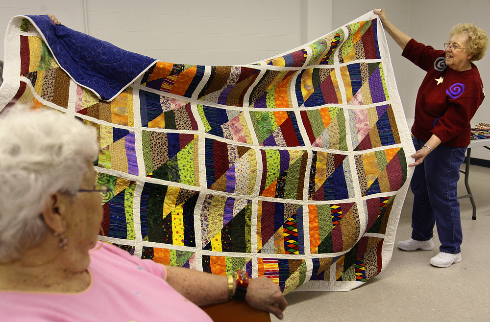 In May of 2009, Rosalie Conklin shows off a quilt that took her more than six months to complete during the show and tell portion of the Springfield Sewing Guild meeting held at the University of Illinois Extension Building on the state fairgrounds in Springfield. file photo by Jason Johnson/The State Journal-Register