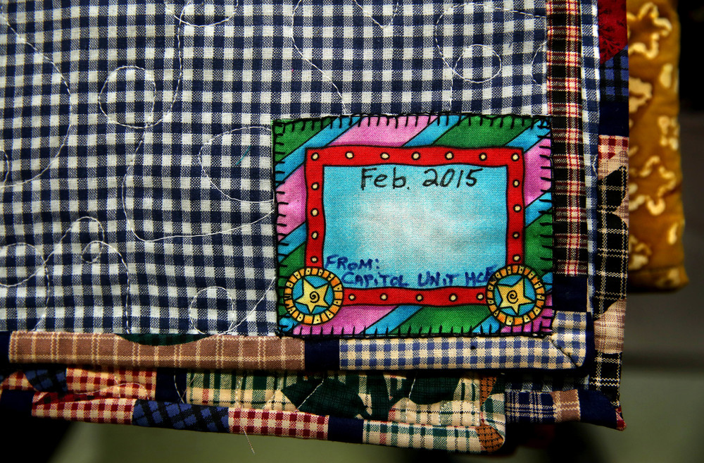 A detail shows one of the stitched name tags located on the corner of each individual quilt. Each quilt tag would soon include the name of a resident living at the home.David Spencer/The State Journal-Register