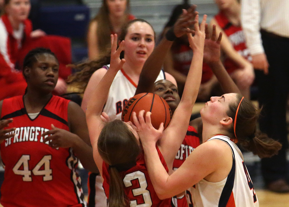 Rochester's Sami Kearney runs into a wall of Springfield players while trying to put up a shot. Rochester defeated Springfield 64-56 to win the girls Central State Eight Conference basketball title game at the Rockets gym on Thursday evening, Feb. 12, 2015. David Spencer/The State Journal-Register