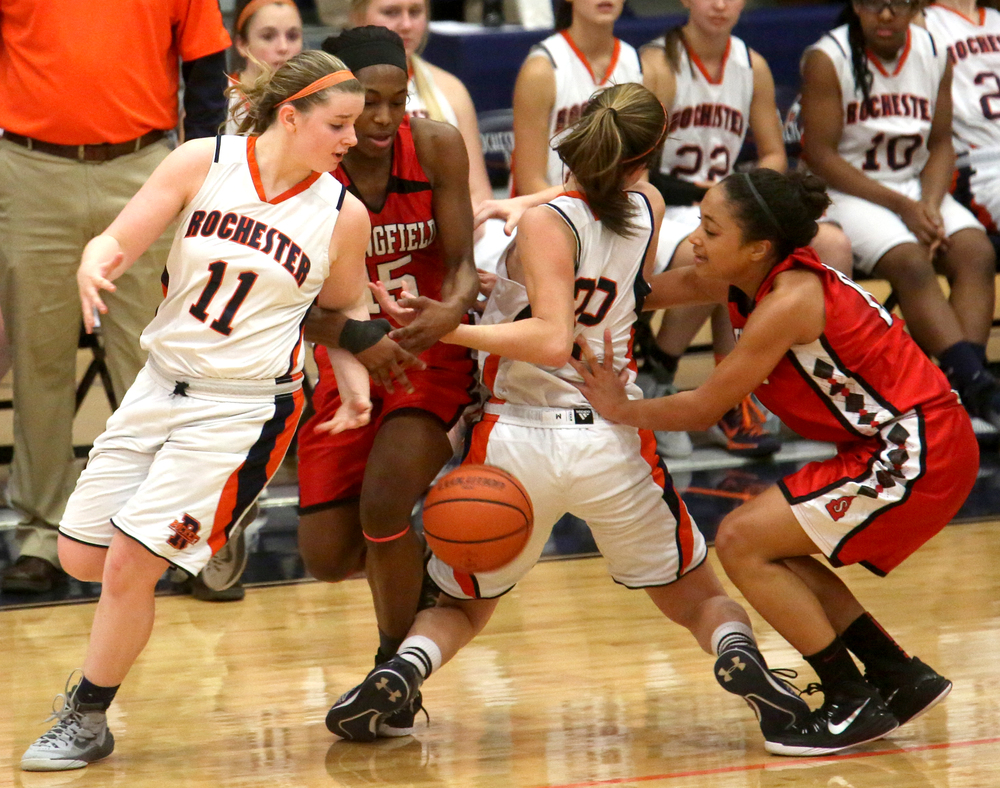A loose ball gets the attention of Rochester's Kylie Clemens at far left along with other players late in the game. Rochester defeated Springfield 64-56 to win the girls Central State Eight Conference basketball title game at the Rockets gym on Thursday evening, Feb. 12, 2015. David Spencer/The State Journal-Register