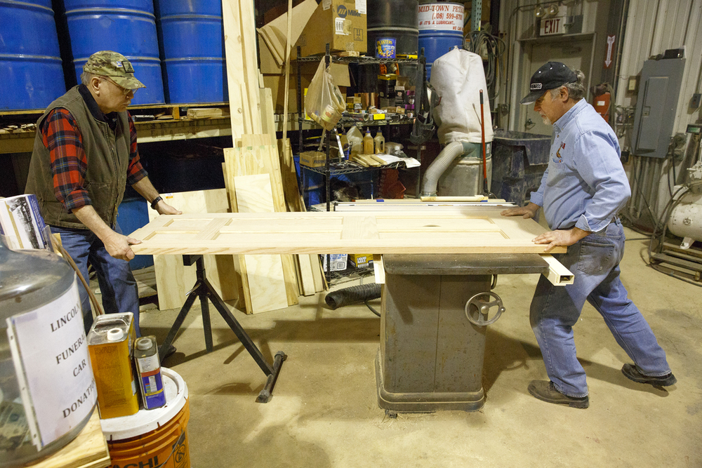 Bob Wonderling, left, senior project manager on the funeral car, and Jerry Mennenga, head carpenter, cut a door panel for the rest room, Jan. 29, 2015. Rich Saal/The State Journal-Register
