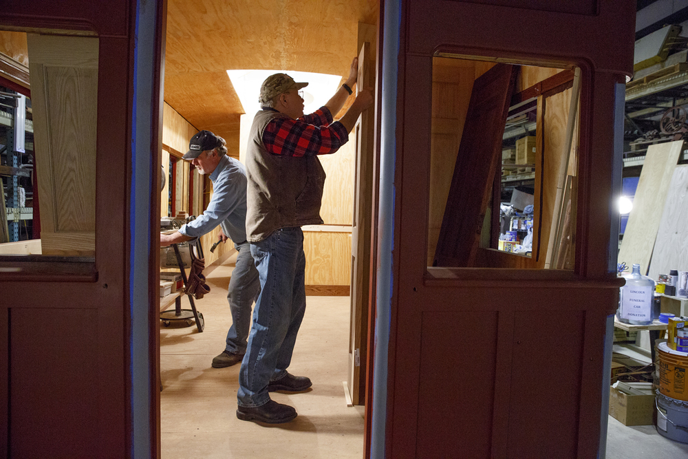 Jerry Mennenga, left, and Bob Wonderling work on the inside of the funeral car Jan. 29, 2015. Rich Saal/The State Journal-Register