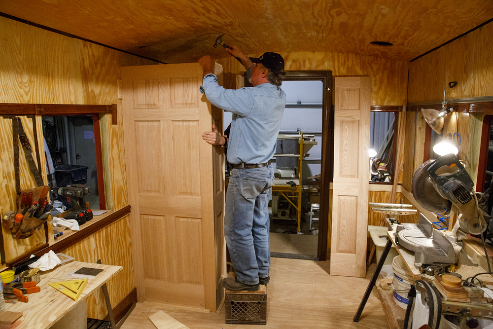 Jerry Mennenga works on the rest room in the funeral car, Jan. 29, 2015. Rich Saal/The State Journal-Register