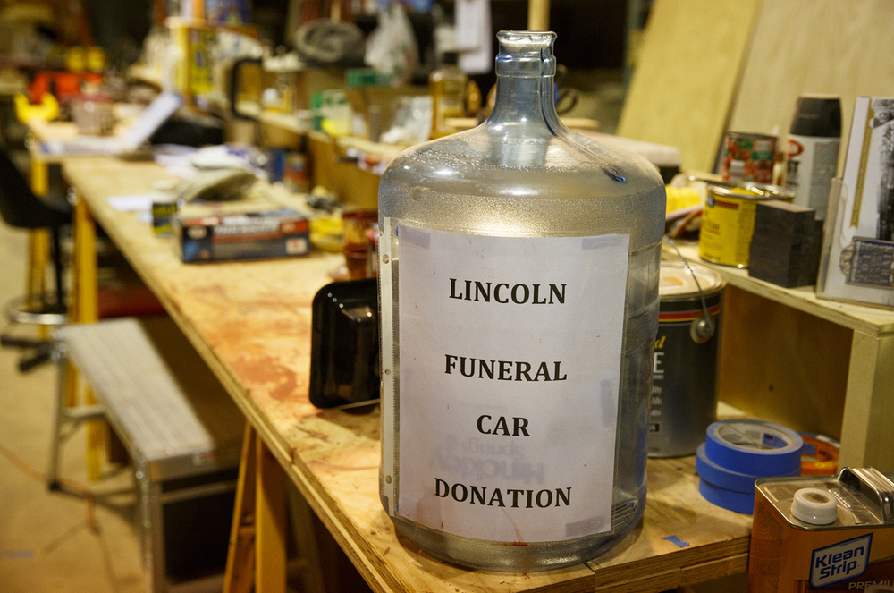 Donations are always welcome to defray the cost of the project. A jar sits on the counter in the workshop where the car is under construction. Rich Saal/The State Journal-Register