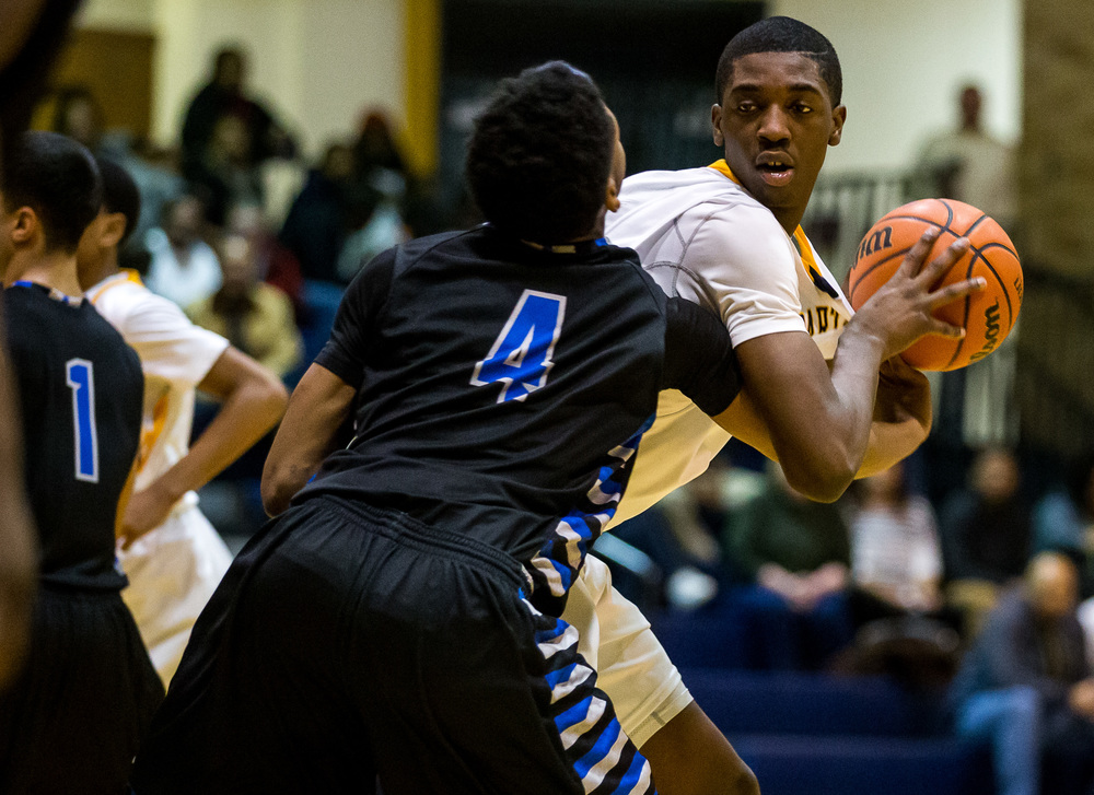 Decatur MacArthur's Terry Bond (4) forces a turnover from Southeast's Darius Ousley (43) in the second half at Southeast High School, Friday, Feb. 13, 2015, in Springfield, Ill. Justin L. Fowler/The State Journal-Register