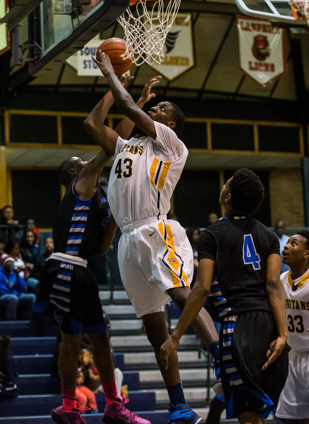 Southeast's Darius Ousley (43) goes up for a basket against Decatur MacArthur's Amir Brummett (25) in the second half at Southeast High School, Friday, Feb. 13, 2015, in Springfield, Ill. Justin L. Fowler/The State Journal-Register