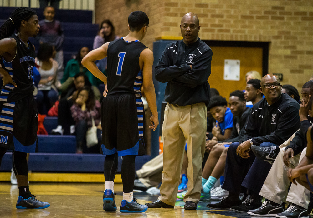 Decatur MacArthur boys basketball head coach Ron Ingram talks with Decatur MacArthur's Dallas McClain (1) during a break in play against Southeast in the second half at Southeast High School, Friday, Feb. 13, 2015, in Springfield, Ill. Justin L. Fowler/The State Journal-Register